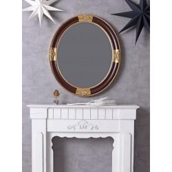 Oglinda rotunda cu o rama aurie cu negru