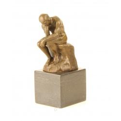 Ganditorul-statueta din bronz pe un soclu din marmura