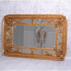 Oglinda monumentala din cristal cu o rama aurie cu decoratiuni